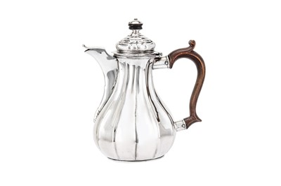 Lot 64-A German silver bachelor coffee pot (verseuse égoiste), bearing marks probably Uberlingen circa 1780 by MFL with a device (untraced)