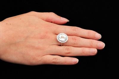 Lot 36-An aquamarine and diamond ring