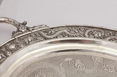 Lot 172 - A large late 19th / early 20th century Chinese Export silver twin handled tray, Canton circa 1900, retailed by Wang Hing