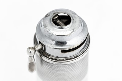 Lot 39-A George V sterling silver table cigar / cigarette lighter, London 1933 by Dyas Beverley Hampton