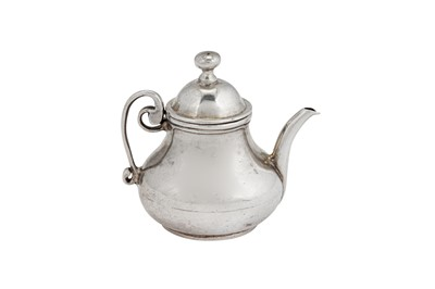 Lot 1-An early 18th century Dutch silver miniature 'toy' teapot, Amsterdam 1738 by Willem van Strant (active 1727-1742)