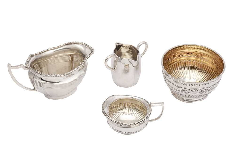 Lot 14-A mixed group of sterling silver milk jug and a sugar bowl