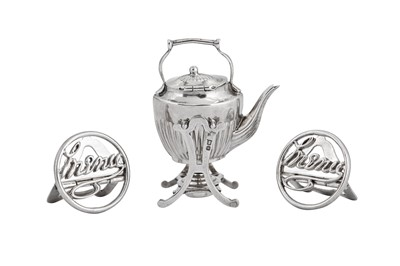 Lot 4-An Edwardian sterling silver miniature toy tipping kettle on burner stand, Chester 1907 by Saunders and Shepard