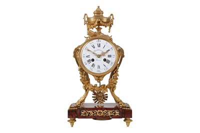 Lot 26-A LAST QUARTER 19TH CENTURY FRENCH ORMOLU AND RED GRIOTTE MARBLE MANTLE CLOCK BY FERDINAND BARBEDIENNE, PARIS