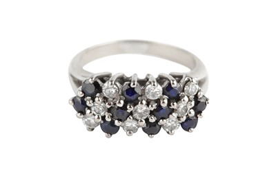 Lot 123-a sapphire and diamond cluster ring