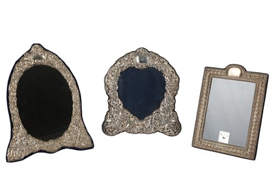 Lot 21-Two silver photograph frames and a mirror