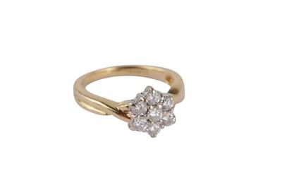 Lot 107-An 18 carat gold diamond cluster ring