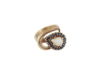Lot 125-An opal and sapphire ring