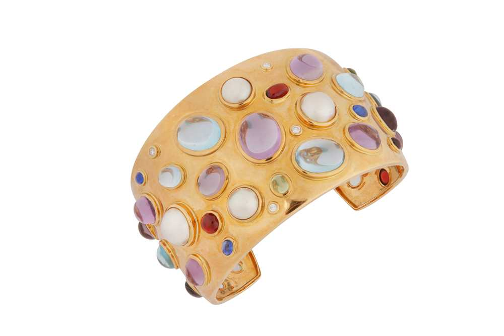 Lot 21-A gold and gem-set cuff, by Kiki McDonough