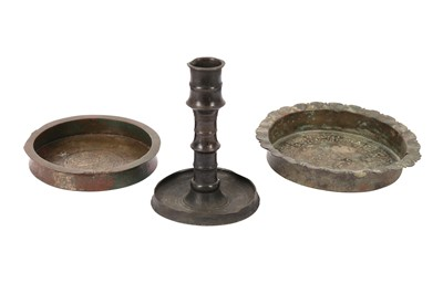 Lot 115-TWO COPPER ALLOY ENGRAVED DISHES AND A CANDLESTICK