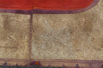 Lot 136-AN EMBROIDERED LEATHER SADDLE COVER