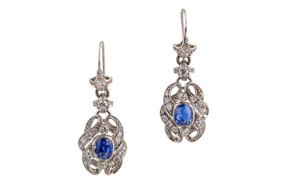 Lot 37-A pair of sapphire and diamond pendent earrings