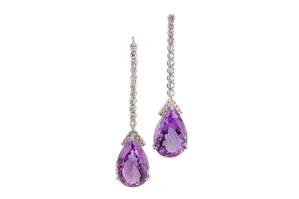 Lot 10-A pair of amethyst and diamond pendent earrings
