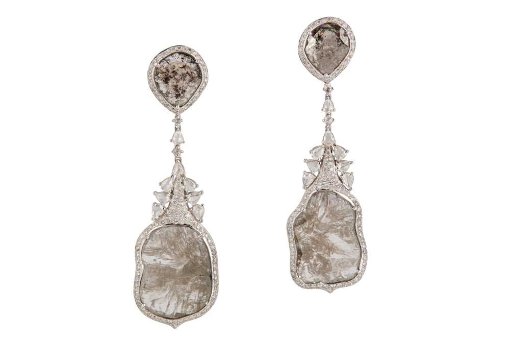 Lot 34-A pair of diamond pendent earrings