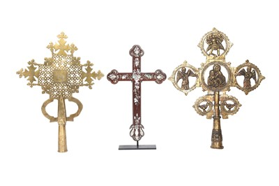 Lot 895-λ TWO ETHIOPIAN BRASS COPTIC CROSSES PATONCE AND A CHINESE MOTHER-OF-PEARL-INLAID ROSEWOOD CRUCIFIX
