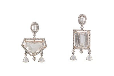 Lot 11-A pair of diamond and white topaz earrings
