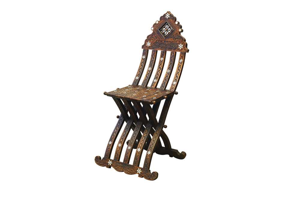 Lot 820-λ A HARDWOOD BONE AND MOTHER-OF-PEARL-INLAID FOLDABLE CHAIR