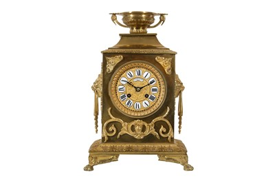 Lot 34-A LATE 19TH CENTURY FRENCH GILT BRONZE MANTEL CLOCK BY LAVASSORT OF PARIS