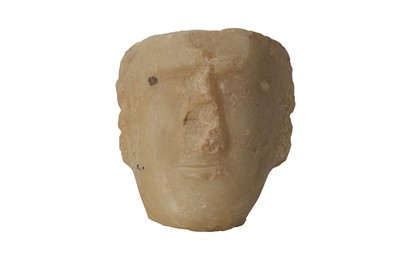 Lot 7-A SOUTH ARABIAN ALABASTER HEAD OF A MAN, CIRCA 1ST CENTURY B.C.- 1ST CENTURY A.D.