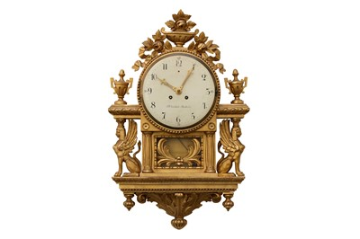 Lot 36-A 19TH CENTURY AND LATER SWEDISH GILTWOOD WALL CLOCK IN THE EMPIRE STYLE