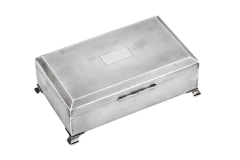 Lot 38-A George VI Art Deco sterling silver cigarette box, Birmingham 1946 by Morris and Baker