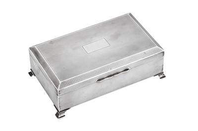 Lot 38 - A George VI Art Deco sterling silver cigarette box, Birmingham 1946 by Morris and Baker
