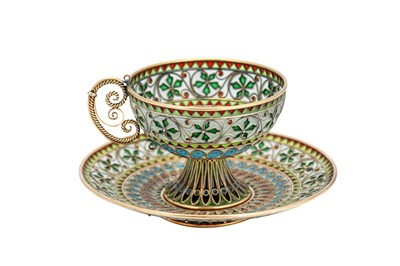 Lot 61-An early 20th century Norwegian 930 standard silver gilt and plique-à-jour enamel cup and saucer, Oslo circa 1910 by Marius Hammer
