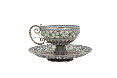 Lot 60-An early 20th century Norwegian 930 standard silver gilt and plique-à-jour enamel cup and saucer, Oslo circa 1910 by Marius Hammer