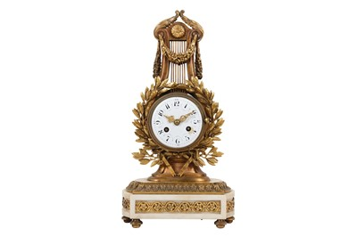 Lot 27-A LATE 19TH CENTURY FRENCH GILT BRONZE AND WHITE MARBLE LYRE MANTEL CLOCK