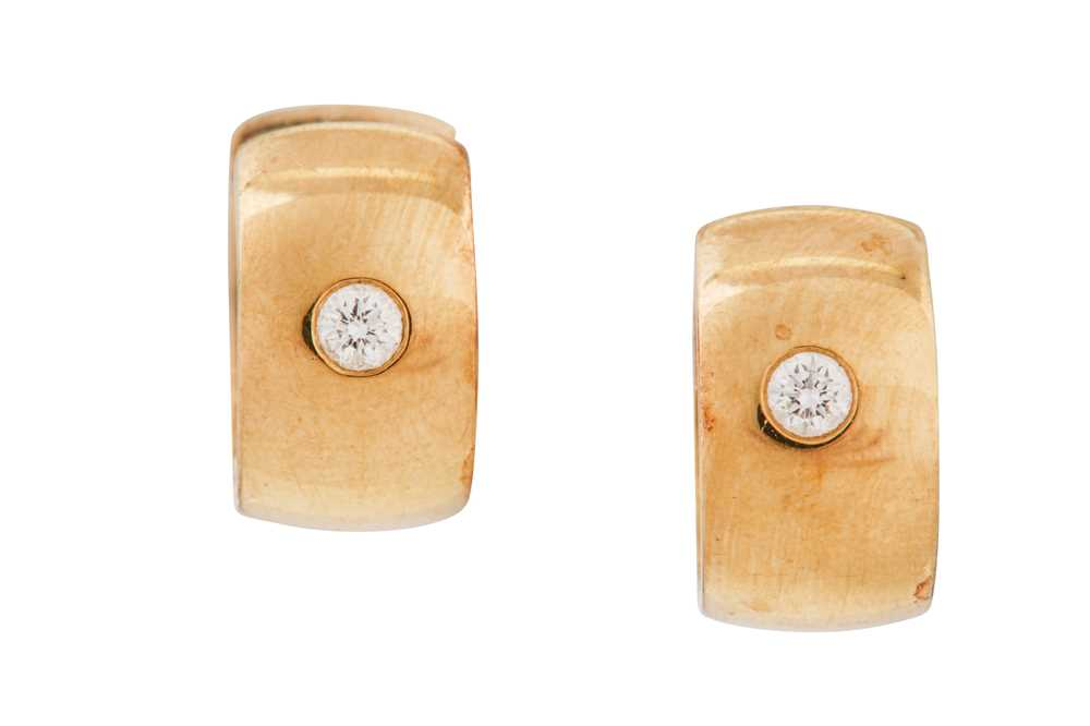 Lot 16-A pair of diamond earrings