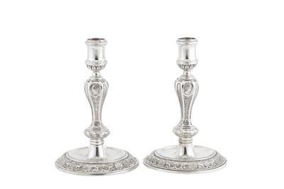 Lot 473 - Welsh Interest - A set of four George I Britannia standard silver candlesticks, London 1725 by Arthur Dicken (reg. 18th June 1720)