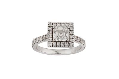 Lot 3-A step-cut diamond cluster ring