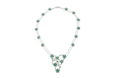 Lot 1222-An emerald and diamond pendant necklace