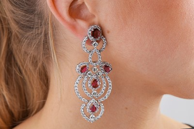 Lot 2-A pair of ruby and diamond pendent earrings