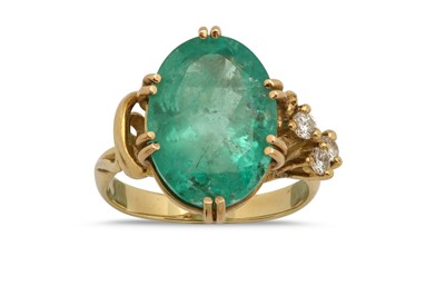 Lot 1238-An emerald and diamond ring