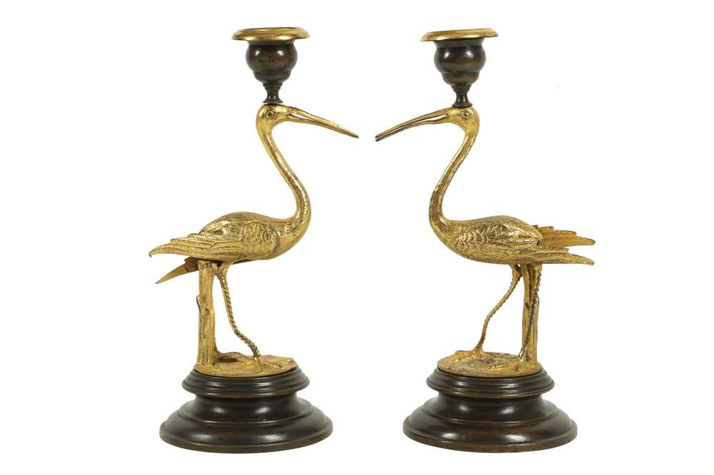 Lot 46 - A PAIR OF GILT AND PATINATED BRONZE STORK CANDLESTICKS IN THE MANNER OF THOMAS ABBOTT