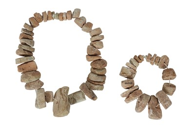 Lot 64-AN ANCIENT CHINESE PERIOD COLLECTION OF CARVED STONE BEADS