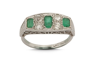 Lot 1232-An emerald and diamond ring