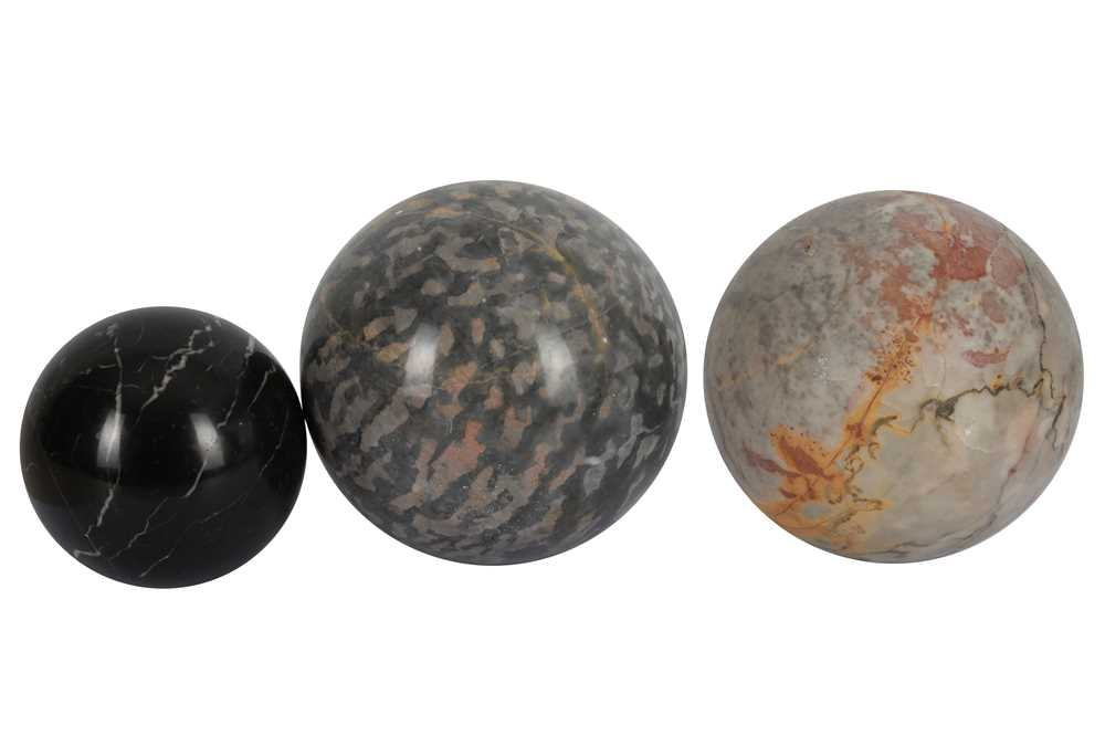 Lot 44-THREE LARGE SOLID MARBLE SPHERES