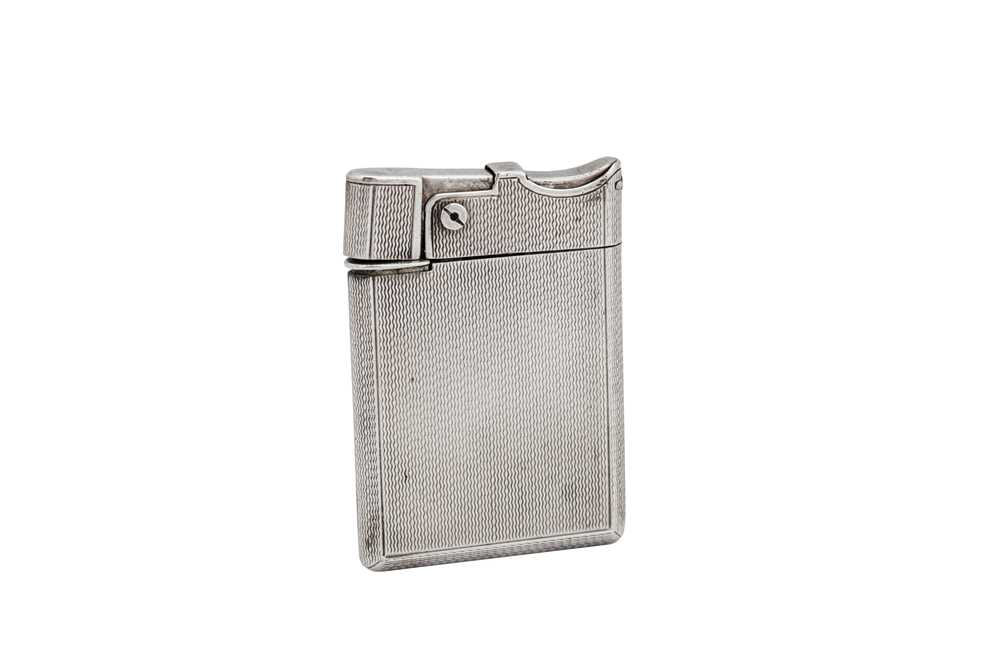 Lot 26-A George VI sterling silver lighter, London 1947 by Asprey and Co