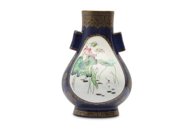 Lot 9 - A CHINESE FAMILLE ROSE POWDER-BLUE GROUND ARROW VASE.
