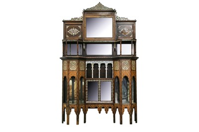 Lot 843-λ A HARDWOOD MOTHER-OF-PEARL-INLAID LIBERTY & CO. OTTOMAN-REVIVAL ORIENTALIST CUPBOARD
