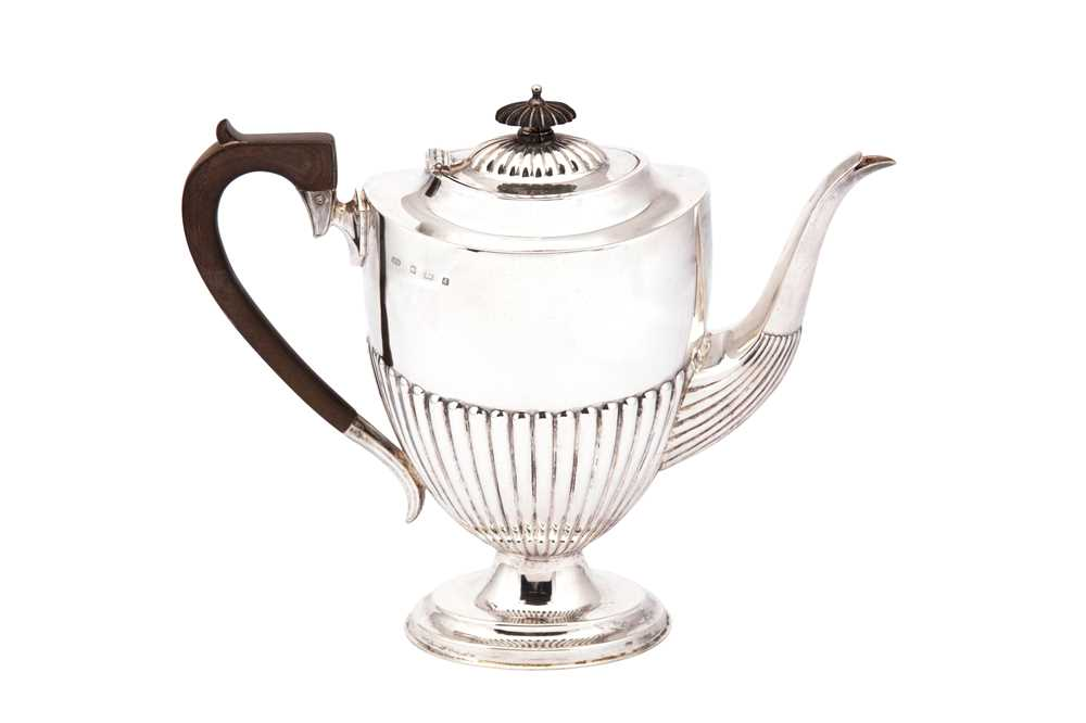 Lot 3-An Edwardian sterling silver coffee pot, Birmingham 1903 by Barker Brothers