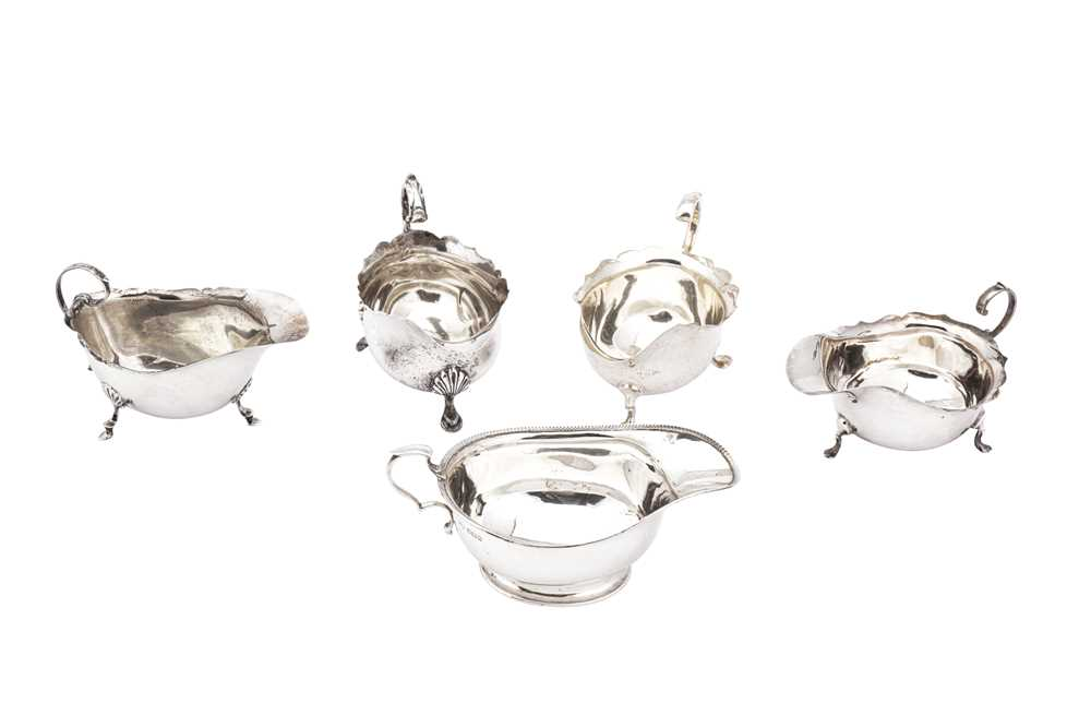 Lot 31-A mixed group of sterling silver sauceboats