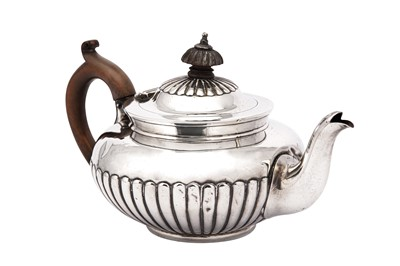 Lot 5-A Victorian sterling silver bachelor teapot, London 1883 by Jackson & Chase