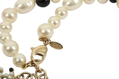 Lot 1207-Chanel Pearl and Black Bead Necklace
