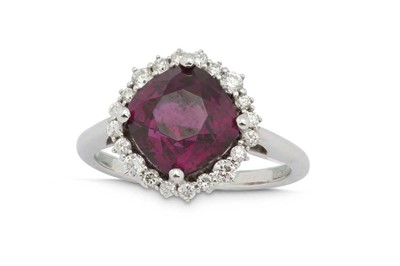 Lot 1212-A garnet and diamond cluster ring