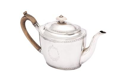 Lot 7-A George III sterling silver teapot, London 1799 by John Merry