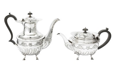 Lot 8-An Edwardian sterling silver four-piece tea and coffee service, Birmingham 1905 by Mappin and Webb
