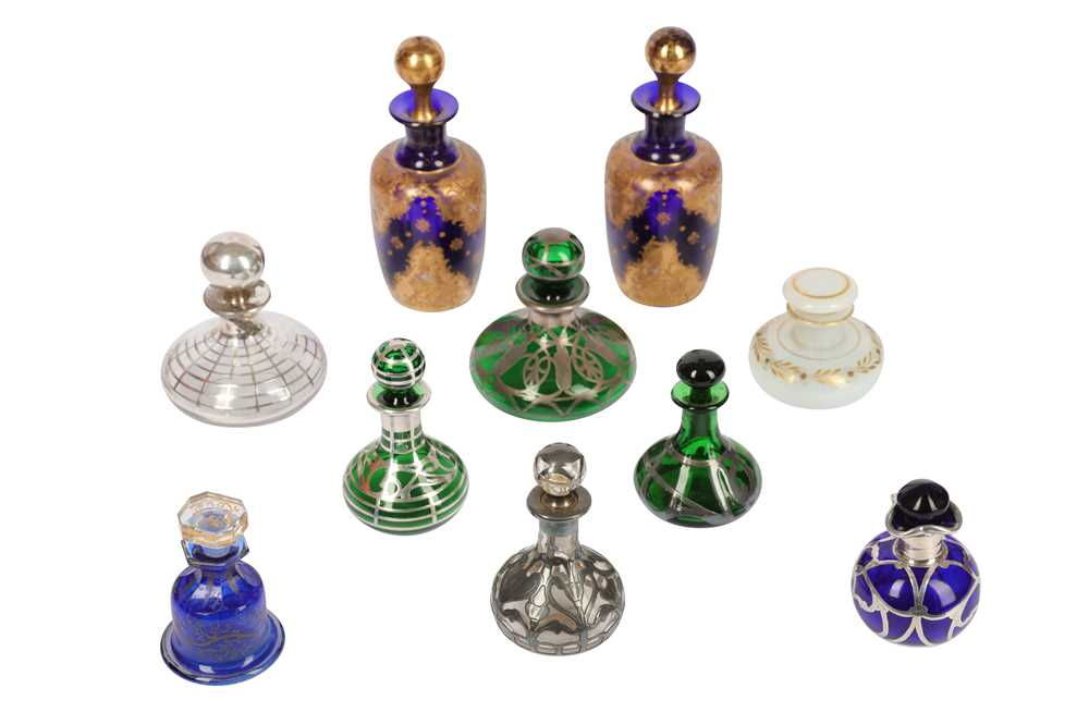 A collection of six early 20th century glass and silvered metal perfume...